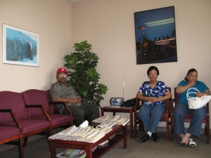 A veteran and a family sit in the waiting room at the Vet Center