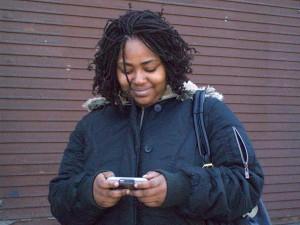 Ashley Cox on smartphone