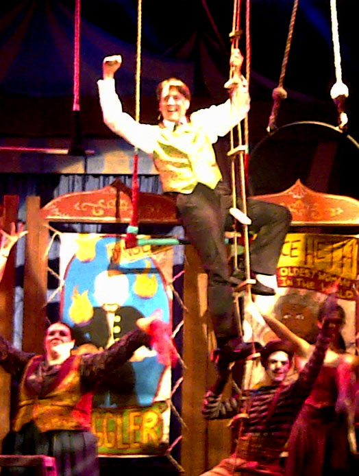 P.T. Barnum sang with some of his circus crew surrounded him.