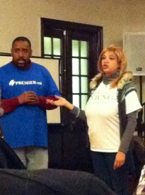 Hopkins (right) organized the five-member panel that spoke to Germantown residents at the meeting.