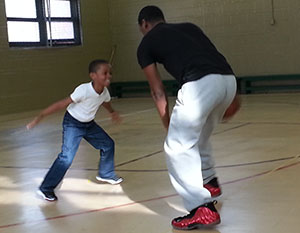 Father and son played one-on-one at the Hunting Park Recreation Center before an Aztecs game.