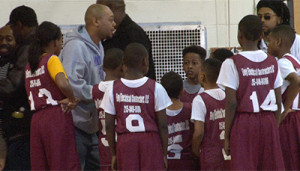 Coach Miles prepped players during a timeout.