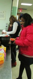 A student lined up to get free snack before being tutored.