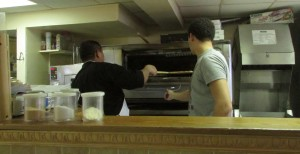 The workers at Mike's pizza were hard at work as they prepared for the day.