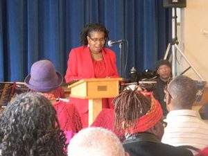 Victoria Huggins Peurifoy, the facilitator of the poetry and discussion group, performed a poem for the audience.