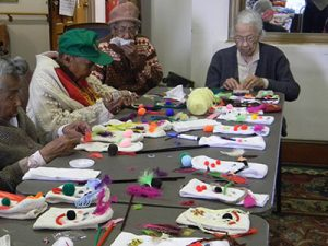 Seniors at Wesley Enhanced Living at Stapely crafted sock puppets for Clowns Without Borders.