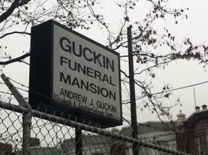 The Guckin Funeral Mansion sign at 3300 G Street.