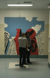 Paintings on the school walls were created by students.