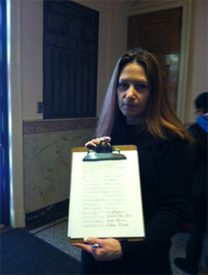 Maria Bellocchio showed the signatures on the petition.
