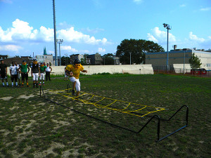Members of the Kensington Tigers practiced their agility on their rock-hard practice field.