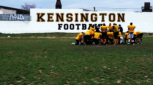The Kensington Tigers huddled beneath their wall after a long practice to discuss what lies ahead.