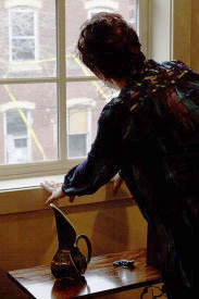Sandy Kauffman, Graduate Hospital resident and real estate agent, looked out of her living room window at a construction site on the 1800 block of Fitzwater Street.
