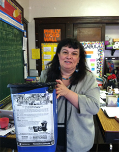 Fiorella DiMarzio, fifth grade teacher and project organizer, taped a list of recyclable items to blue bins throughout the school.
