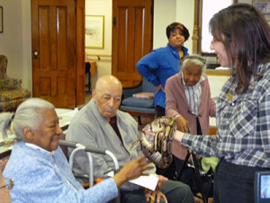 Briar Bush Nature Center brought a boa constrictor to visit Stapeley seniors.