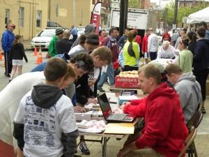 Volunteers take part in registering the 5K participants.