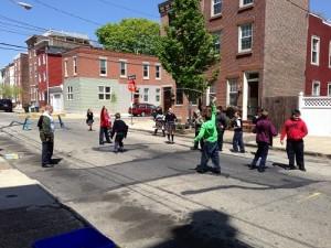 The children of St. Laurentius enjoy recess on Berks St.