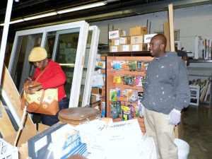 Volunteer Bryant Corley (right) drives an hour every Saturday to help out at ReStore.