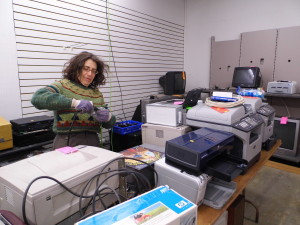 Deborah Kosak from One Brick is able to use her retail experience to test donated electronics.