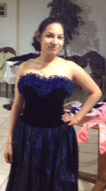 Yuri Osorio, a junior at One Bright Ray High School posed after trying on a gown.