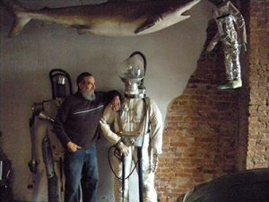 Vazquez posed with one of his many creations in the living room of his house on the 3300 block of North 5th Street.
