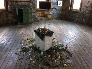 """Elisa Esposito's centerpiece, """"Collapsed Colony,"""" shows the sudden death of a colony of bees."""