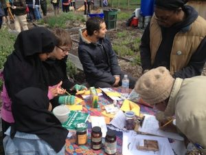 Residents gathered at the Philadelphia Seed Exchange table to collect different seed breeds to garden themselves.