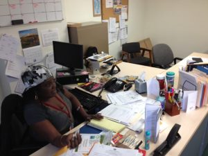 In their temporary office, Millicent Ayers explained what services have been provided for Carroll Park since taking over the area.