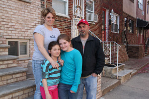 Rita Cairey, left, stood with daughters and friend, Nathan, outside of her Bigler Street home.