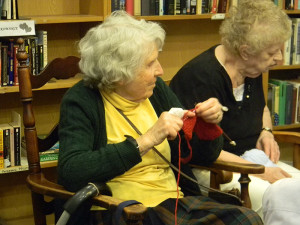 The Knit Wits meet weekly to knit blankets and articles of clothing for charity.