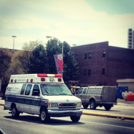 An ambulance speeds away from a Penn hospital. Those without insurance often rely on the services at emergency rooms.