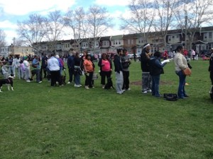Residents gathered in the park to wait for their pets' vaccinations.
