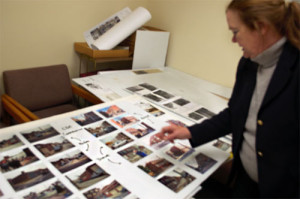Spring Garden Civic Association board member Patricia Freeland looked through photographs of the properties the association has helped renovate.