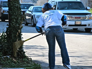 Ann Moss swept along the block while other volunteers shoveled and got refreshments ready.
