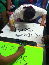 Carmen Martcet, made posters along with several others in Philadelphia before they went to D.C.