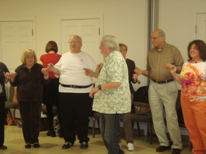 Group instructor Bill Wadlinger (center) led the class in a dance.