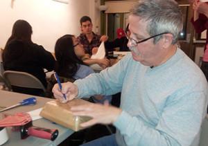 Mike Santarelli spent his Tuesday night volunteering at Books Through Bars.