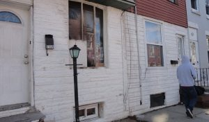 The house on Belgrade Street was targeted last week. Its damages were still visible despite being boarded up.