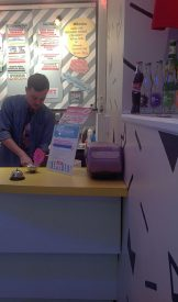 Little Baby's Ice Cream worker Josh Decker scooped ice cream for a guest.