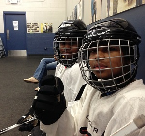 Students Kyle and Maxwell Lapsley in their hockey gear