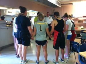 St. Francis Inn volunteers prayed before serving dinner.