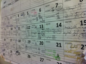 A calendar hanging at St. Francis Inn shows the capacity of how many meals they serve throughout the week.
