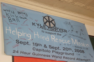 A banner hangs in the renovated Youth Center, covered in signatures of those involved with the 24-hour Kickball Marathon.