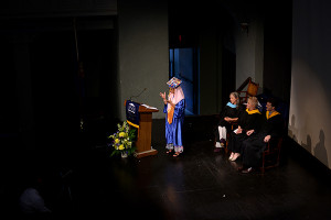 Valedictorian Naima Boudreaux signs a speech at PSD's graduation ceremony on Friday morning.