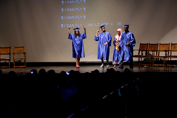 "Graduates Sacha Ramos, Mark Gonzales,Taji Brown and Naima Boudreaux signed the song ""I believe I can fly."""