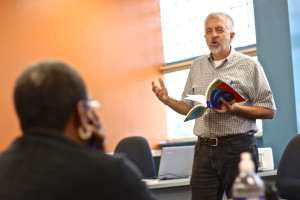 Community Learning Center teacher Jim Landers teaches a GED class at West Philadelphia Community Center.