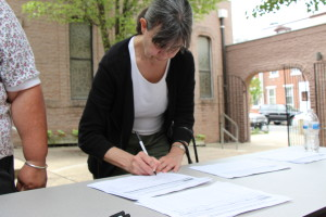 St. Joachim member signs petition to keep St. Joachim open.