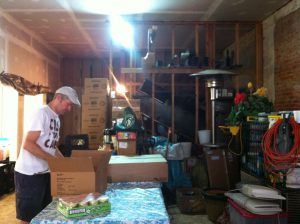 Cast Your Cares founder Jim Snider unloaded food to distribute from his storage space.
