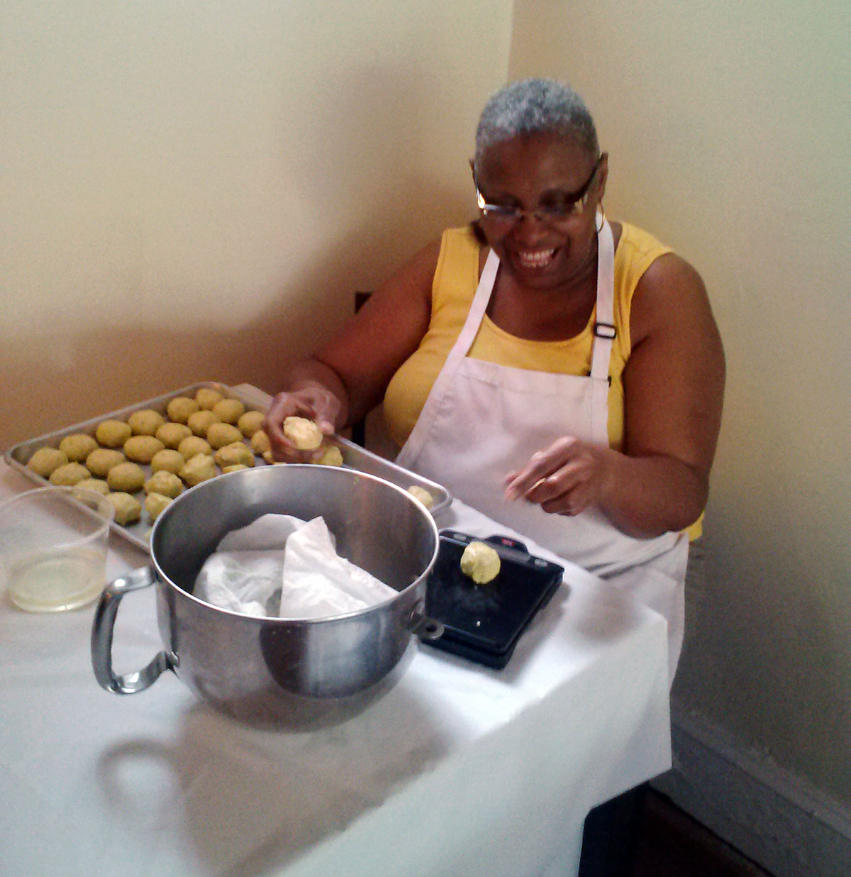 Claudette Campbell rolls dough inside the restaurant she manages with her daughter.