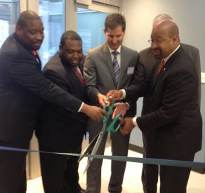 Mayor Michael Nutter (right) helps cut the ribbon at the grand opening of Valley Green Bank in South Philadelphia.