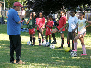 Coach Walter gives a pep talk to the girls at practice in Vernon Park
